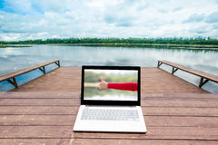 Laptop on wooden table Royalty Free Stock Photo