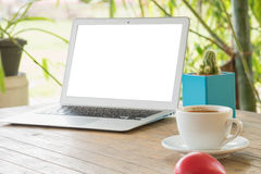 Laptop on a wooden table outdoors royalty free stock images