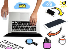 Laptop with work equipments around Stock Images