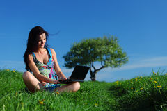 Laptop work in field Stock Images
