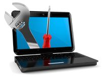 Laptop with work tools. On white background Royalty Free Stock Photos
