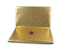 Laptop wrapped in golden gift paper isolated on white Stock Photography