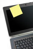 Laptop and yellow sticky note Stock Image