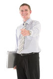 Laptop for you. Businessman carrying laptop and pointing finger over white backdrop Royalty Free Stock Photos