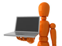Laptop for you. Orange mannequin with gray laptop Royalty Free Stock Photo
