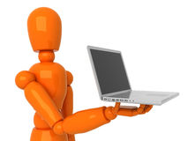 Laptop for you. Orange mannequin with gray laptop Stock Photo