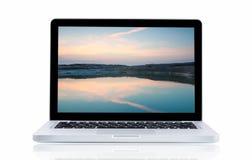 Laptop z krajobrazowym Sam Phan bokiem Obrazy Stock
