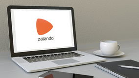 Laptop with Zalando logo on the screen. Modern workplace conceptual editorial 3D rendering Royalty Free Stock Images