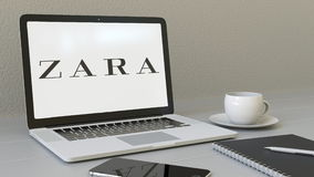 Laptop with Zara logo on the screen. Modern workplace conceptual editorial 3D rendering royalty free illustration