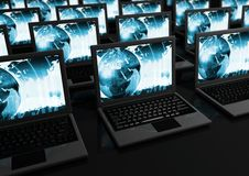 Laptops. Closeup of Laptops on black reflective surface Royalty Free Stock Images
