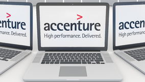 Laptops with Accenture logo on the screen. Computer technology conceptual editorial 3D rendering Stock Photos