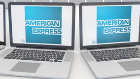 Laptops with American Express logo on the screen. Computer technology conceptual editorial 4K clip, seamless loop. Laptops with American Express logo on the stock video footage