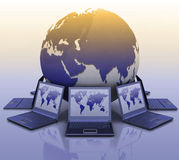 Laptops around a globe Stock Photo