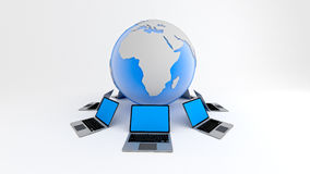 Laptops around globe. Global network concept. Royalty Free Stock Photo