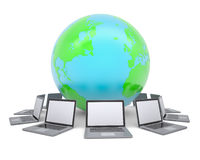 Laptops around the planet earth Stock Images