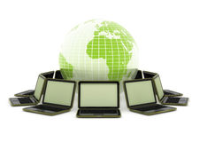 Laptops around the world. 3d computer generated image of computer laptops around a green globe isolated on white Stock Photography
