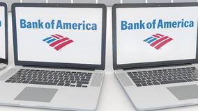 Laptops with Bank of America logo on the screen. Computer technology conceptual editorial 4K clip, seamless loop. Laptops with Bank of America logo on the screen stock video footage
