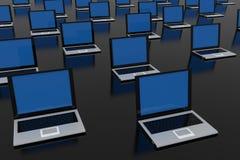 Laptops on black glossy surface. Stock Image