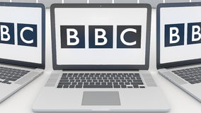 Laptops with British Broadcasting Corporation BBC logo on the screen. Computer technology conceptual editorial 3D.  Stock Photography