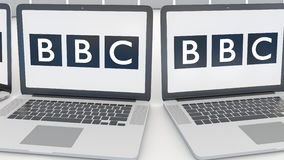Laptops with British Broadcasting Corporation BBC logo on the screen. Computer technology conceptual editorial 4K clip. Laptops with British Broadcasting royalty free illustration