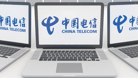 Laptops with China Telecom logo on the screen. Computer technology conceptual editorial 3D rendering Royalty Free Stock Images