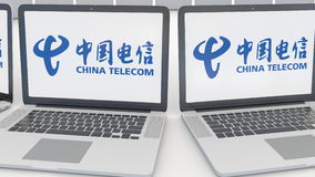 Laptops with China Telecom logo on the screen. Computer technology conceptual editorial 4K clip, seamless loop stock video footage