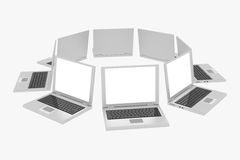 Laptops in circle isolated on white Stock Photo