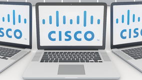 Laptops with Cisco Systems logo on the screen. Computer technology conceptual editorial 3D rendering Stock Photos