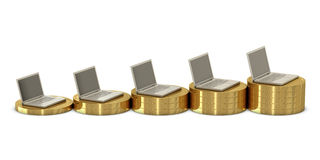 Laptops on coins chart Royalty Free Stock Photo