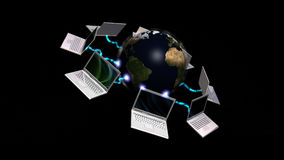 Laptops connected to planet Earth Royalty Free Stock Images