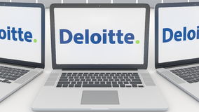 Laptops with Deloitte logo on the screen. Computer technology conceptual editorial 3D rendering. Laptops with Deloitte logo on the screen. Computer technology Royalty Free Stock Photo