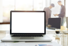 Laptops on desk in office with morning light on blur business te Stock Image