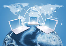 Laptops with Earth and world map Royalty Free Stock Image