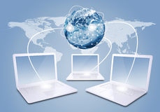 Laptops with Earth and world map Stock Image