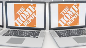 Laptops with The Home Depot logo on the screen. Computer technology conceptual editorial 4K clip, seamless loop. Laptops with The Home Depot logo on the screen stock video