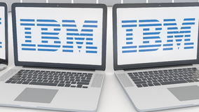 Laptops with IBM logo on the screen. Computer technology conceptual editorial 4K clip, seamless loop. Laptops with IBM logo on the screen. Computer technology stock video footage