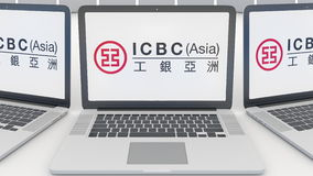 Laptops with Industrial and Commercial Bank of China ICBC logo on the screen. Computer technology conceptual editorial Stock Photos