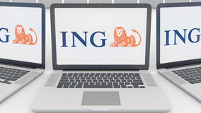 Laptops with ING Group logo on the screen. Computer technology conceptual editorial 3D rendering Royalty Free Stock Photos
