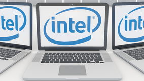 Laptops with Intel Corporation logo on the screen. Computer technology conceptual editorial 3D rendering Royalty Free Stock Photo