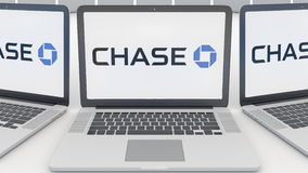 Laptops with JPMorgan Chase Bank logo on the screen. Computer technology conceptual editorial 3D rendering Stock Photography