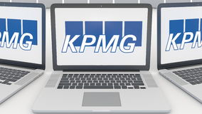 Laptops with KPMG logo on the screen. Computer technology conceptual editorial 3D rendering. Laptops with KPMG logo on the screen. Computer technology conceptual Stock Photos