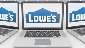 Laptops with Lowe`s logo on the screen. Computer technology conceptual editorial 3D rendering Royalty Free Stock Photography