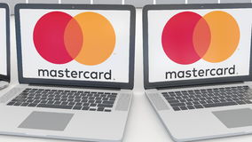 Laptops with MasterCard logo on the screen. Computer technology conceptual editorial 4K clip, seamless loop. Laptops with MasterCard logo on the screen. Computer stock video footage