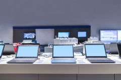 Laptops in the modern electronics store. Computer department in the technology store.  stock image