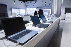 Laptops in a modern technology store. Department of computers in the electronics store. laptop in the store. Laptops in a modern technology store. Department of stock image