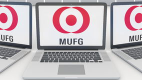 Laptops with MUFG logo on the screen. Computer technology conceptual editorial 3D rendering Royalty Free Stock Image