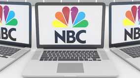Laptops with National Broadcasting Company NBC logo on the screen. Computer technology conceptual editorial 3D rendering Stock Images