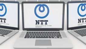Laptops with Nippon Telegraph and Telephone Corporation NTT logo on the screen. Computer technology conceptual editorial Royalty Free Stock Image
