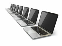 Laptops in a row on white background Stock Photo