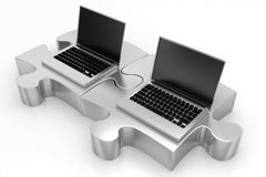 Laptops and Silver Puzzles Royalty Free Stock Images
